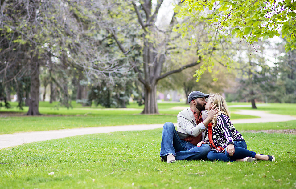 Denver City Park Engagement Session - Sarah and Luis kissing under a tree