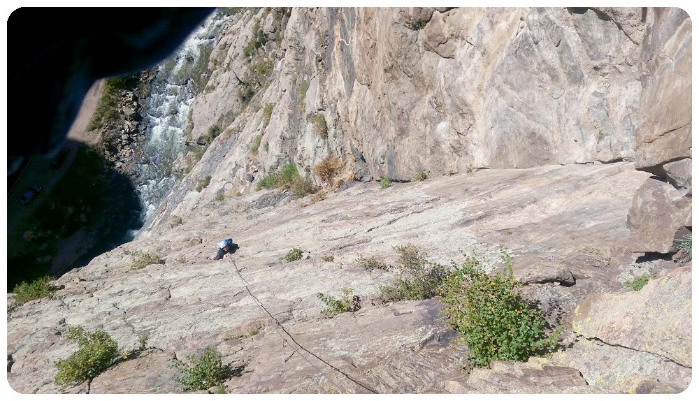 Rayna climbing the last pitch of Playin' Hooky