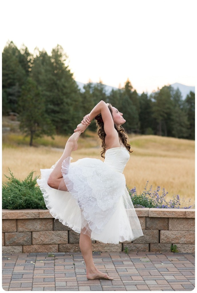 Colorado bride doing a yoga pose in her wedding dress by Rayna McGinnis