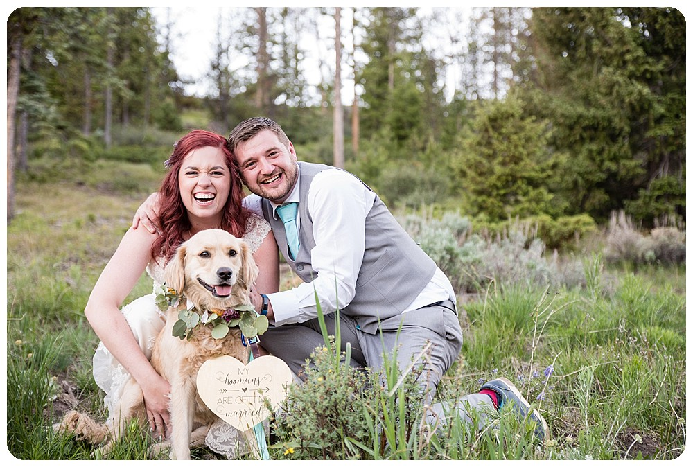 Family photo of bride, groom and their dog
