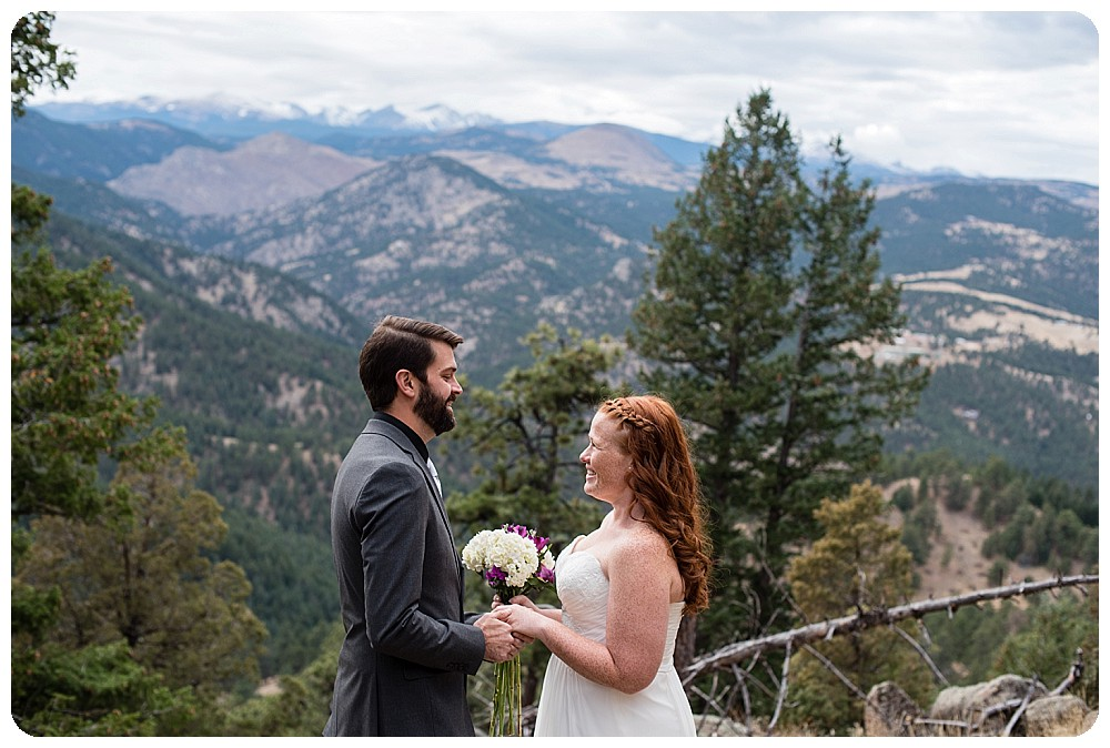 Bride and groom exchanging vows at their Flagstaff Mountain Elopement