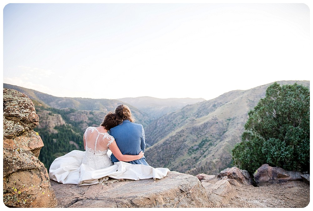 Bride and Groom sitting on top of Lookout Mountain in Golden, Colorado