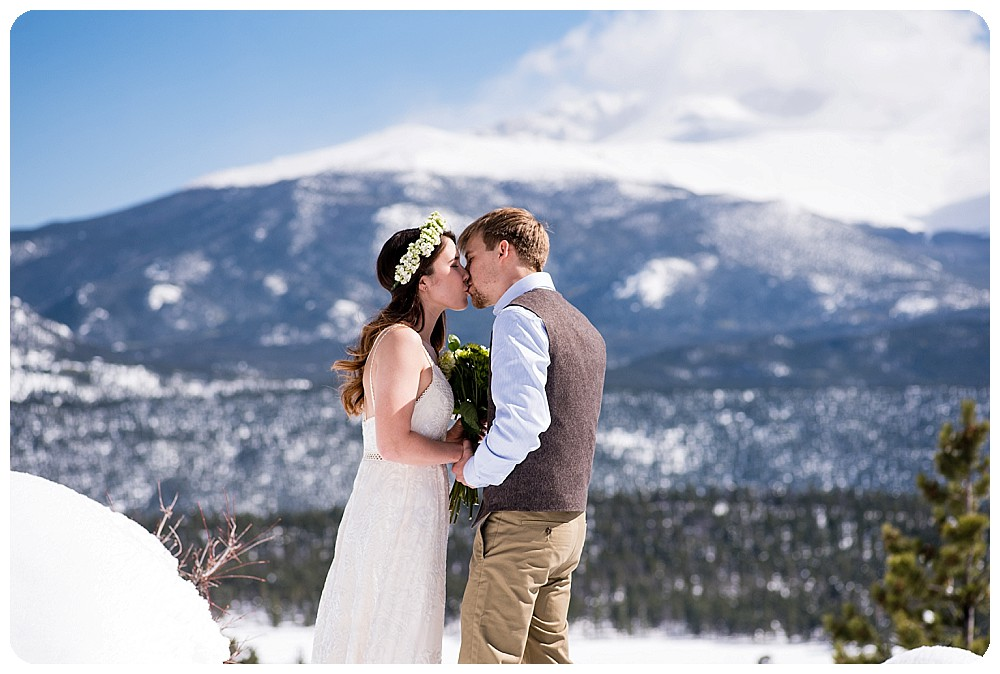 Destination Mountain Elopement Ceremony at 3M Curve in Rocky Mountain - First Kiss
