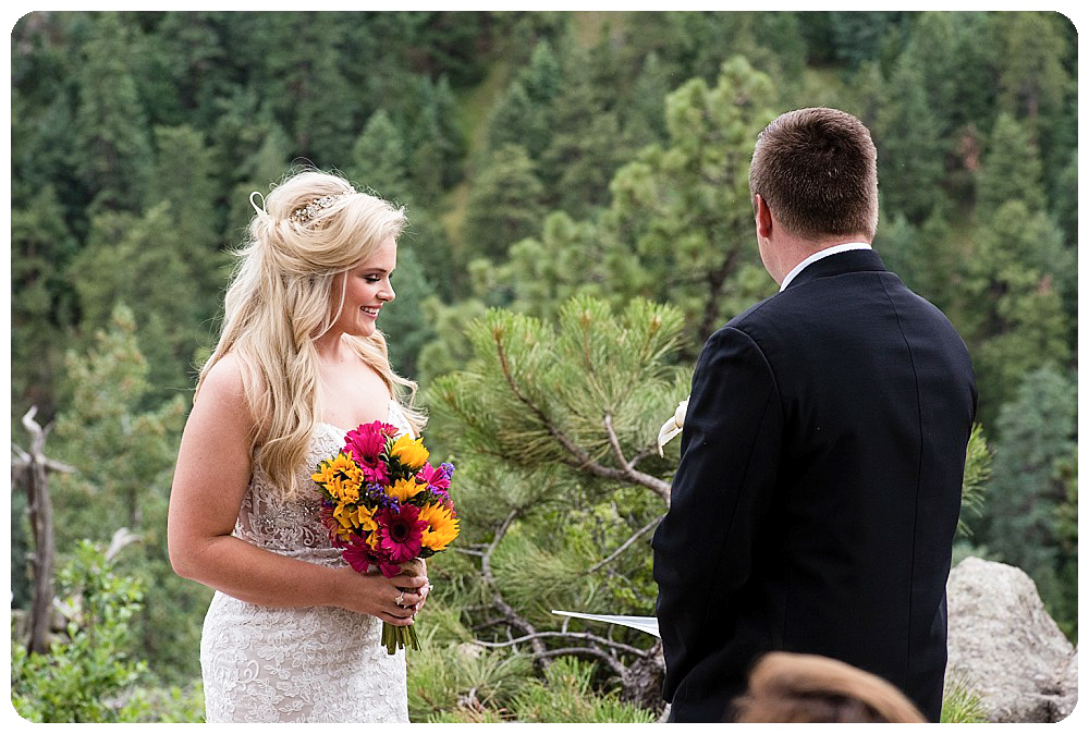 Megan and Richard exchanging vows at their Colorado elopement