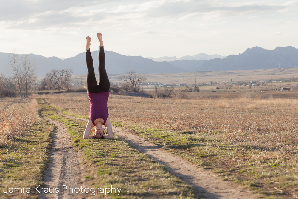 Active Wedding Photographer, Rayna McGinnis doing a Headstand