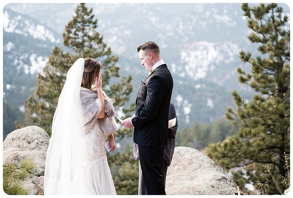 exchanging vows at Colorado Elopement in Boulder, Colorado
