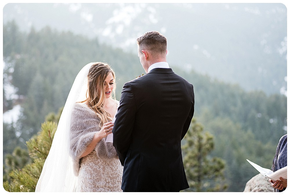 Exchanging vows at Colorado Winter Elopement