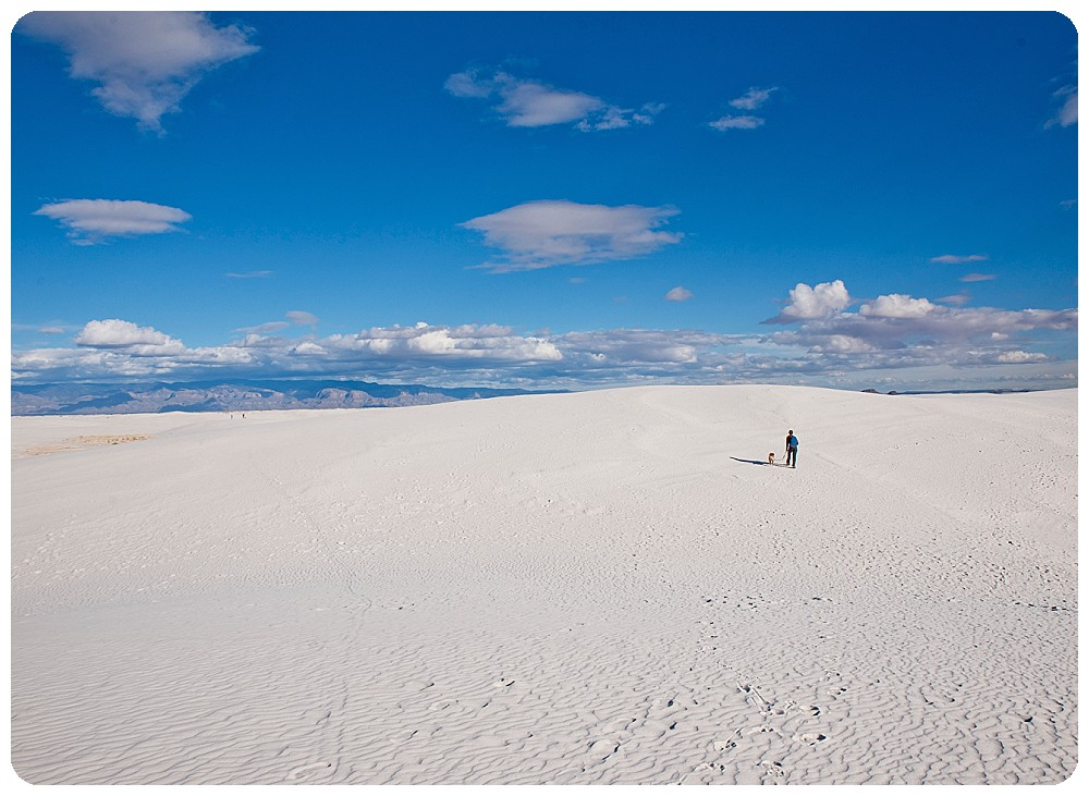 White Sands Elopement Photographer walking with dog in New Mexico