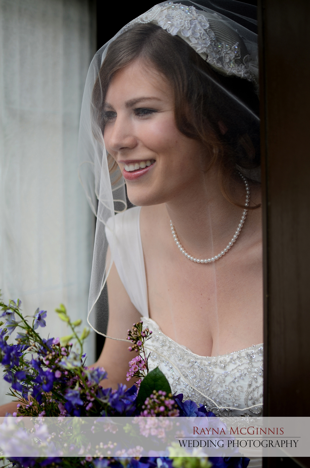 Bride peaking out the door at the Briarwood Inn