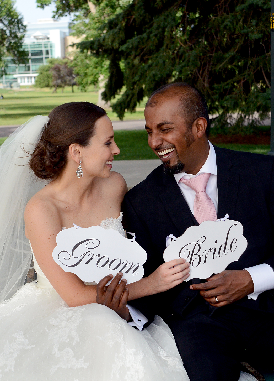 Cute Bride and Groom signs at Denver Museum of Nature and Science Wedding
