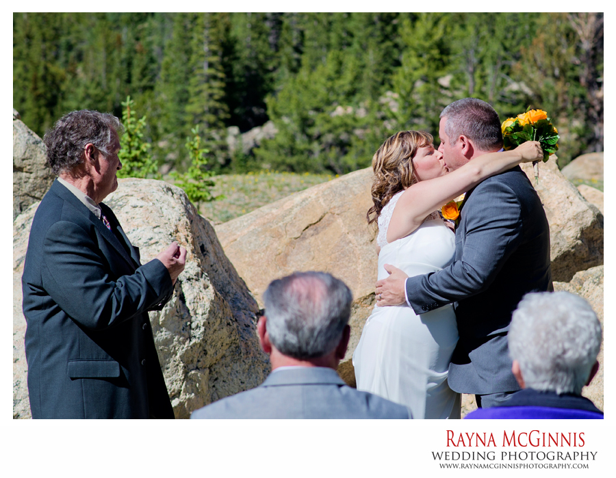 First kiss at wedding ceremony at clear lake