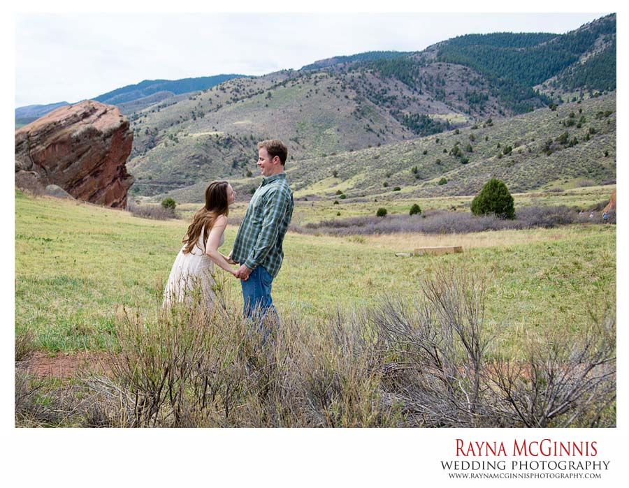 Couple playing at engagement session in Red Rocks Park